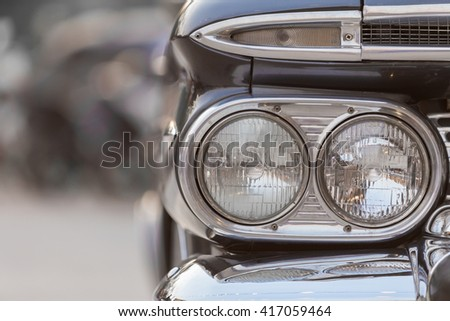 Retro styled image of a front head lamp classic car