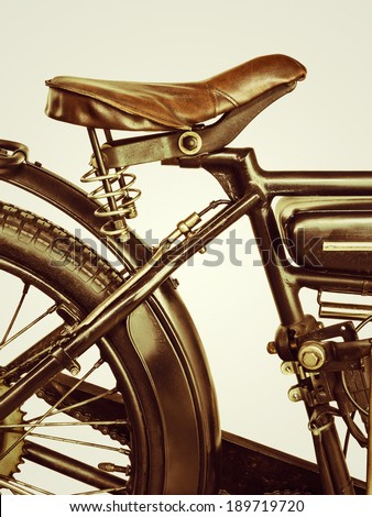 Retro styled image of a motorcycle saddle on a vintage sepia background - stock photo
