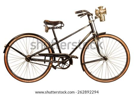Retro styled image of a nineteenth century lady bicycle with lantern isolated on a white background - stock photo
