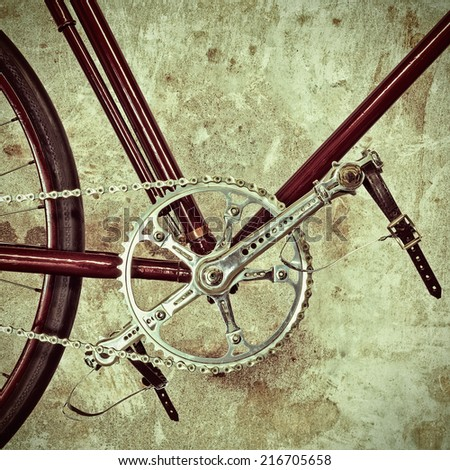 Retro styled image of a part of an old bicycle with derailleur gears - stock photo