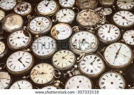Retro styled image of old scratched and run down pocket watches - stock photo