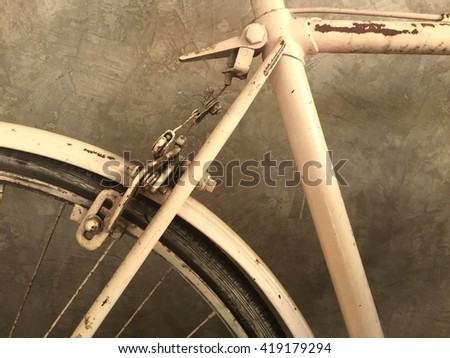 Retro styled image of part an old rusty bicycle