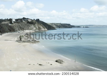 Retro-styled image of Tenby Beach in South Wales, UK. - stock photo