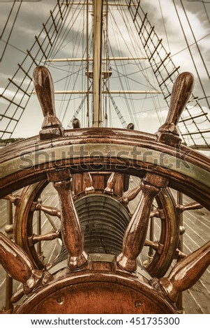 Retro styled image of the steering wheel of a sail boat - stock photo