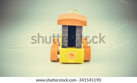 Retro styled or retro color blocks of wooden train. Concept of classic logistic transportation education. Slightly de-focused and close-up shot. Copy space. - stock photo