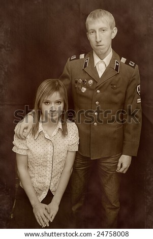 retro-styled portrait oa young soldier and girl - stock photo
