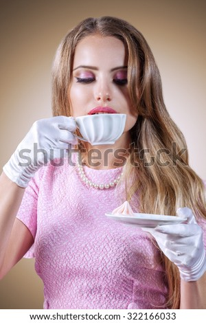 Retro styled portrait of elegant young woman with tea