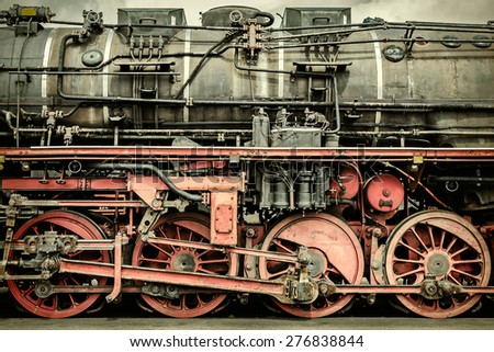 Retro styled side view of an old rusted steam locomotive - stock photo