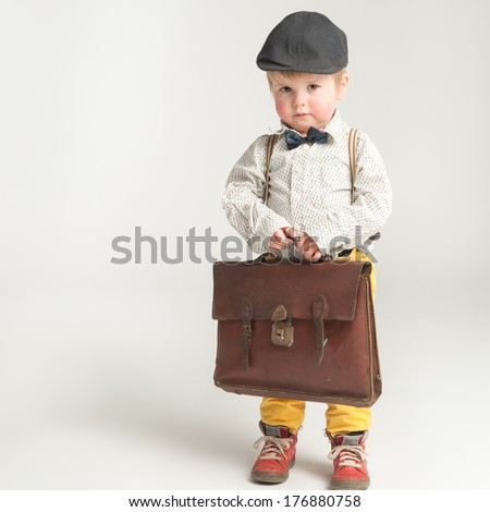 Retro styled toddler is a bit afraid for going to school - stock photo