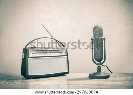 Retro sudio microphone and old radio receiver from 60s. Vintage style sepia photo - stock photo