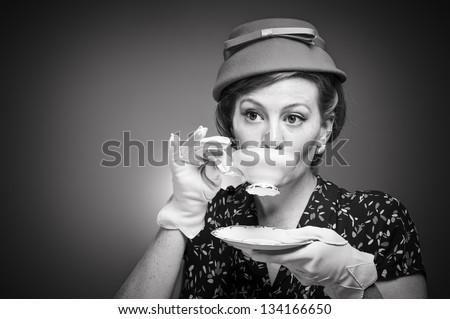 Retro tea drinking woman - stock photo