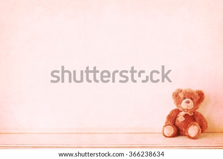 Retro Teddy Bear toy alone on wooden floor.Vintage - stock photo