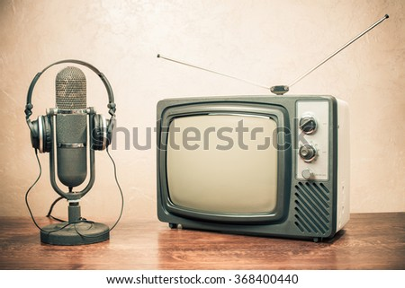 Retro television, headphones and old microphone from 50s. Vintage style filtered photo