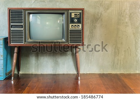 Retro television in the old room - stock photo