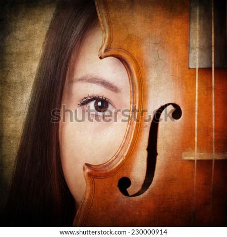 retro themed music concept girl portrait with violin - stock photo