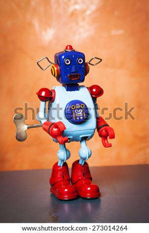 Retro tin robot. Surprised face. - stock photo