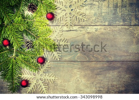 Retro toned Christmas decorations on an old wooden table, copy space, shallow depth of field.