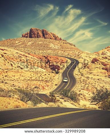 Retro toned winding desert highway, travel adventure concept, USA. - stock photo