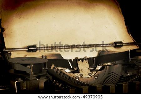 retro typewriter with paper - stock photo