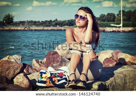 Retro vacation / Retro style image from a beautiful young woman on her vacations - stock photo