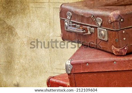 retro valise bags suitcases  on the old vintage textured paper background collection