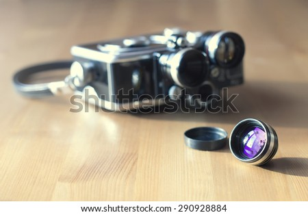 Retro video camera and its small lens - stock photo
