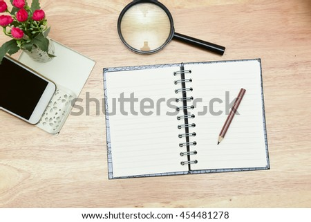 Retro vintage  process.Business planning with copy space and office supplies.Have Blurry mobile and magnifying glasses ,mobile and glasses on wood background as props.