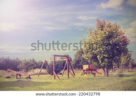 Retro vintage style picture of playground in park. - stock photo
