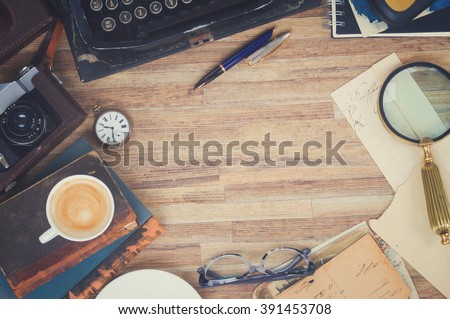retro vintage typewriter  with supplies on working table with copy space, top view, retro toned - stock photo