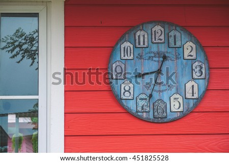 Retro wall clock on red wooden background - stock photo