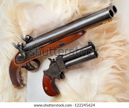Retro wallpaper with british colonial pistols from the early 19th century. This gun's use as the last line of defense against an attacking tiger and other dangerous animal. - stock photo