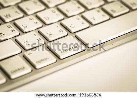 Retro white computer keyboard. Selective focus. - stock photo