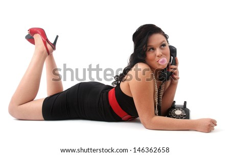 retro woman chewing gun talking at phone - stock photo