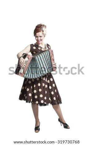 Retro woman in vintage polka dots dress with accordion - stock photo