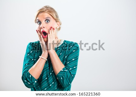 Retro woman is very shocked because of something,Shocked woman - stock photo