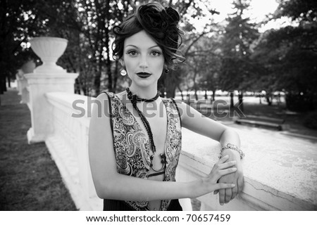 Retro Woman Portrait. Beautiful Woman. Vintage Styled Photo. Old Fashioned Makeup and Finger Wave Hairstyle. 20 or 30 style - stock photo