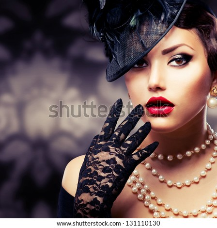 Retro Woman Portrait. Vintage Style Girl Wearing Old fashioned Hat and Gloves, retro Hairstyle and Make-up - stock photo