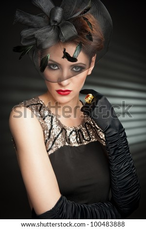 Retro Woman Portrait with black glover and professional makeup posing in studio - stock photo