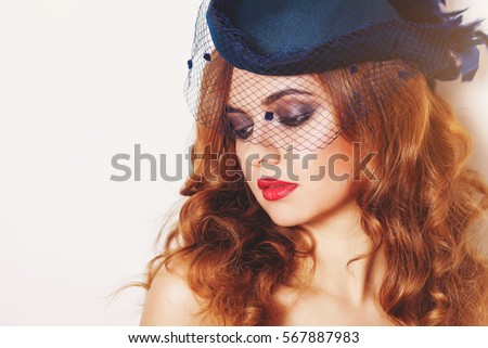 Retro woman with beautiful hairdo and little hat