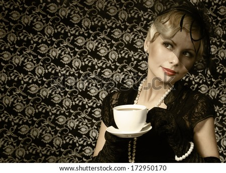 Retro Woman with Coffee Cup. Portrait of Fashion Beautiful Blonde. Vintage style.  - stock photo