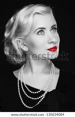 Retro woman with red lips. Black and white photo - stock photo