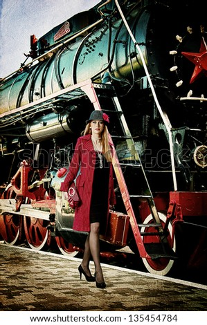 Retro Woman with suitcase at the train station - stock photo