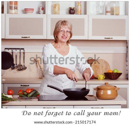 Retro. Woman working in the kitchen. Mom while she work something else. Mother prepares a salad. Cooking. Woman while preparing food in kitchen. Beautiful adult multiracial woman while making lunch. - stock photo