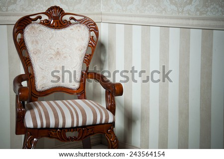 Retro wooden chair in empty room against light beige wallpapers. Copy space - stock photo