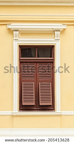 Retro Wooden Window with shutters in colonial architecture style building - stock photo