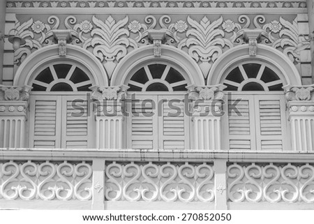 Retro wooden windows and decoration of Chino-Portuguese style architecture in Phuket, Thailand