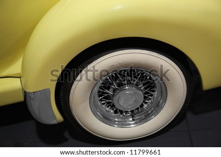 retro yellow car. close-up of old-fashioned gum-dipped  tires