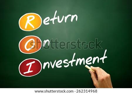 Return On Investment (ROI) acronym, business concept on blackboard - stock photo