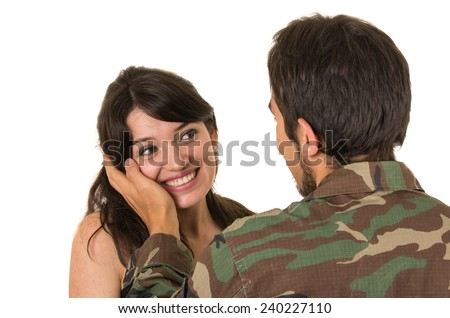 returning young military soldier caressing his wife girlfriend isolated on white - stock photo
