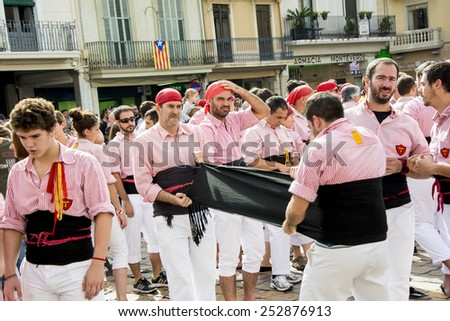 REUS, SPAIN - OCTOBER 25, 2014: Castells Performance, a castell is a human tower built traditionally in festivals within Catalonia. This is alsoon the UNESCO Intangible Cultural Heritage of Humanity